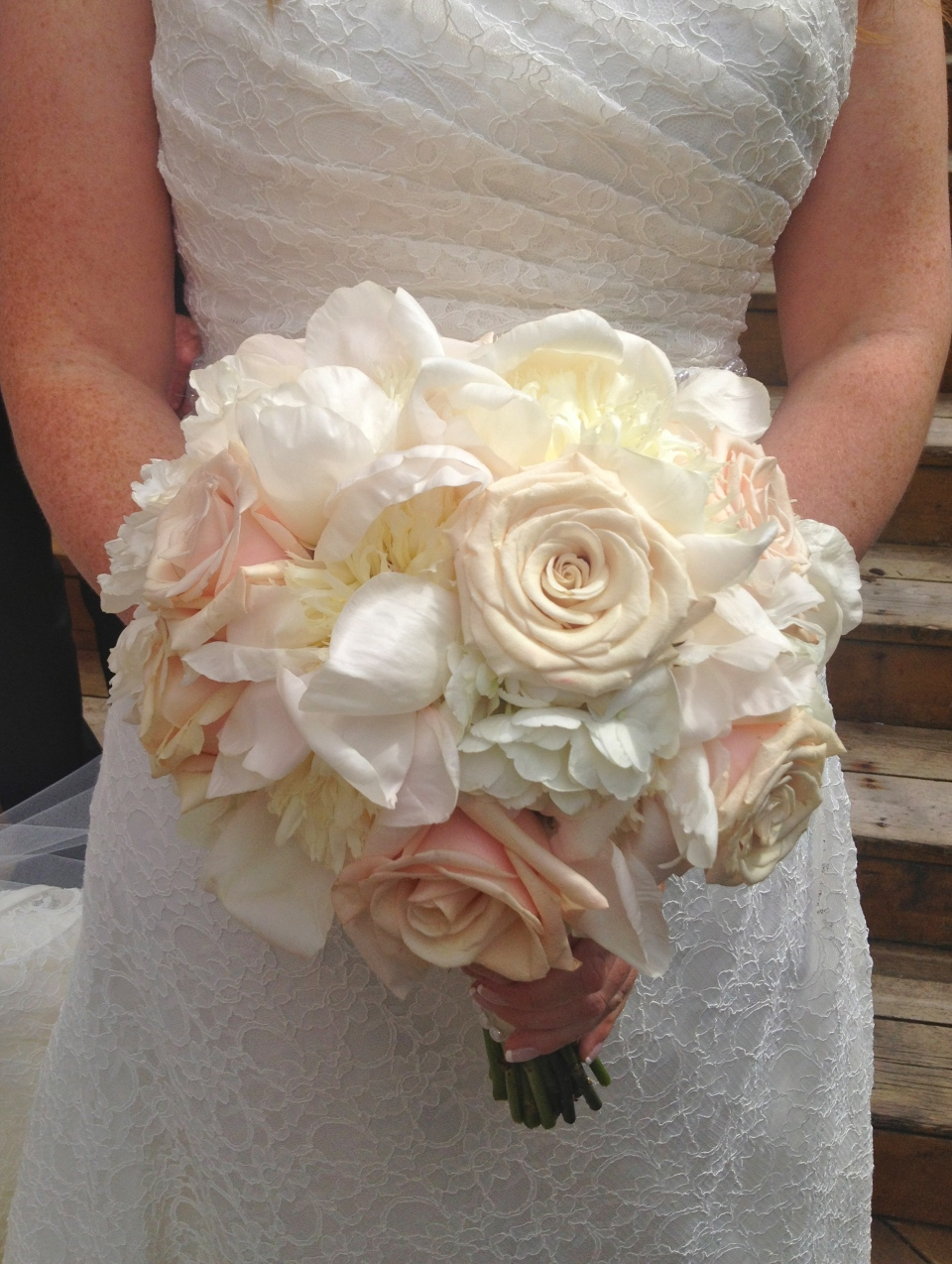 Bridal bouquet of white peonies, hydrangea & champagne roses