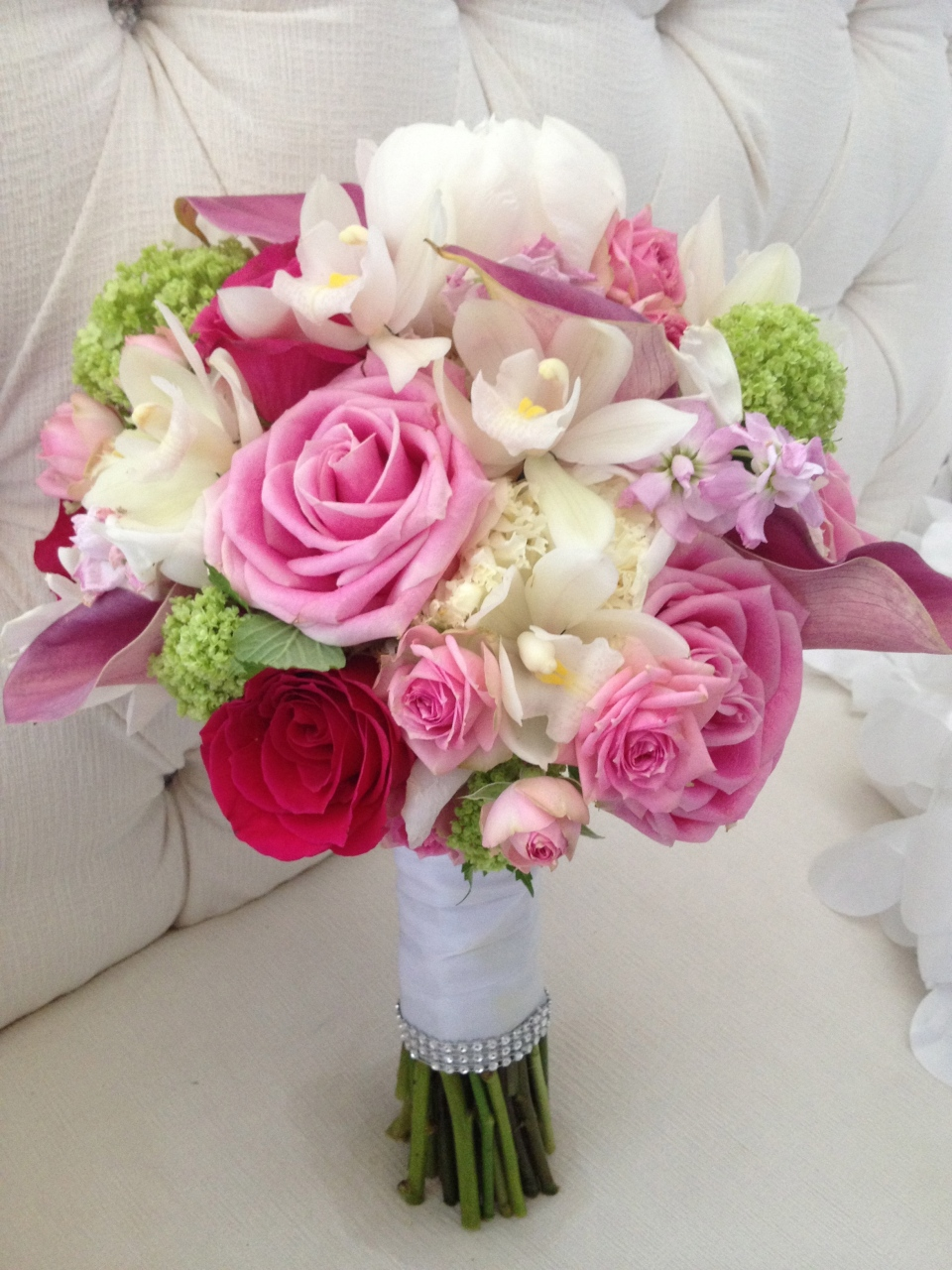 Bridal bouquet of roses, peonies, spray roses, calla lilies, vibernum, stock & mini cymbidium orchids