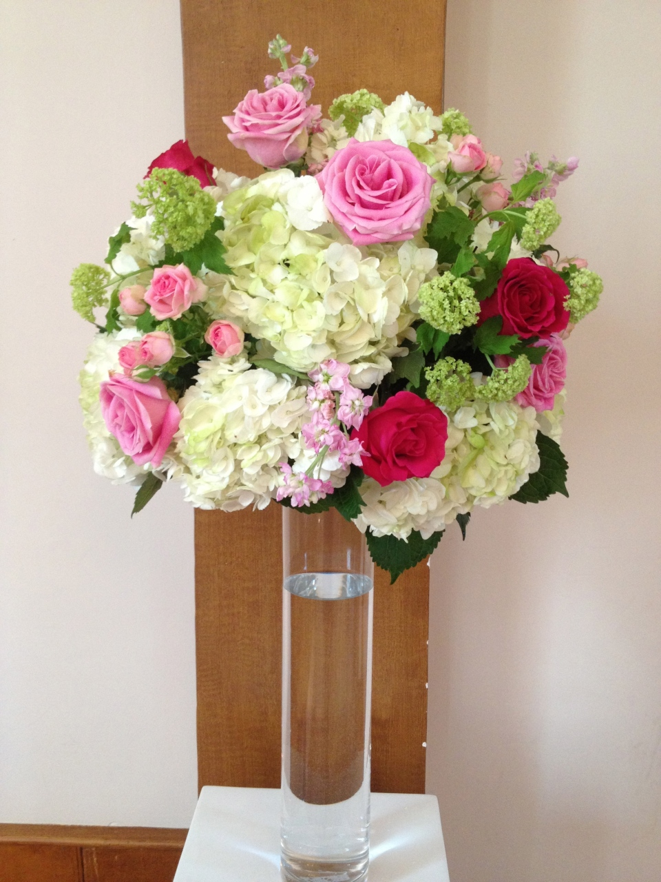 Altar pieces of hydrangea, roses, spray roses, stock and viburnum