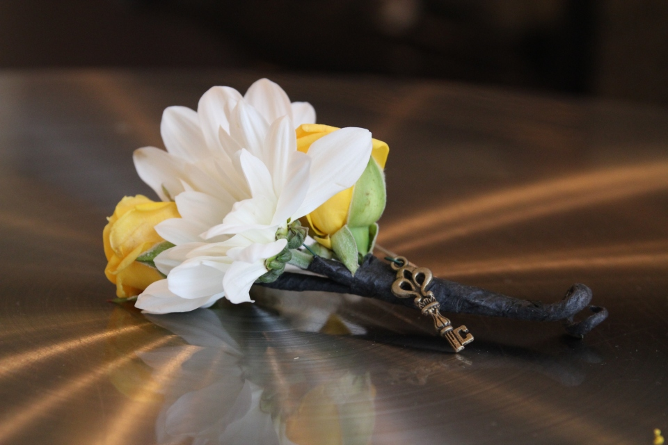 Groom's boutonniere featured a miniature key that matched the lock on the bride's bouquet