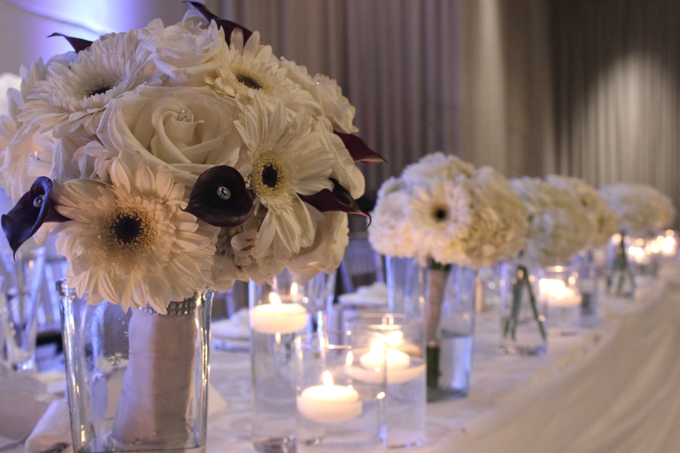 Bouquets lined up on the head table