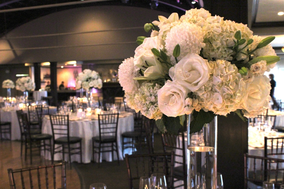 White Centerpieces of Hydrangea, Roses, Lilies and Mums