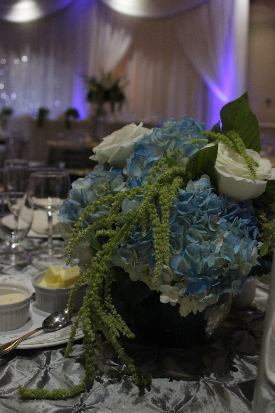 Low Blue and Green Centerpiece with Hydrangea, Roses and Amaranthus