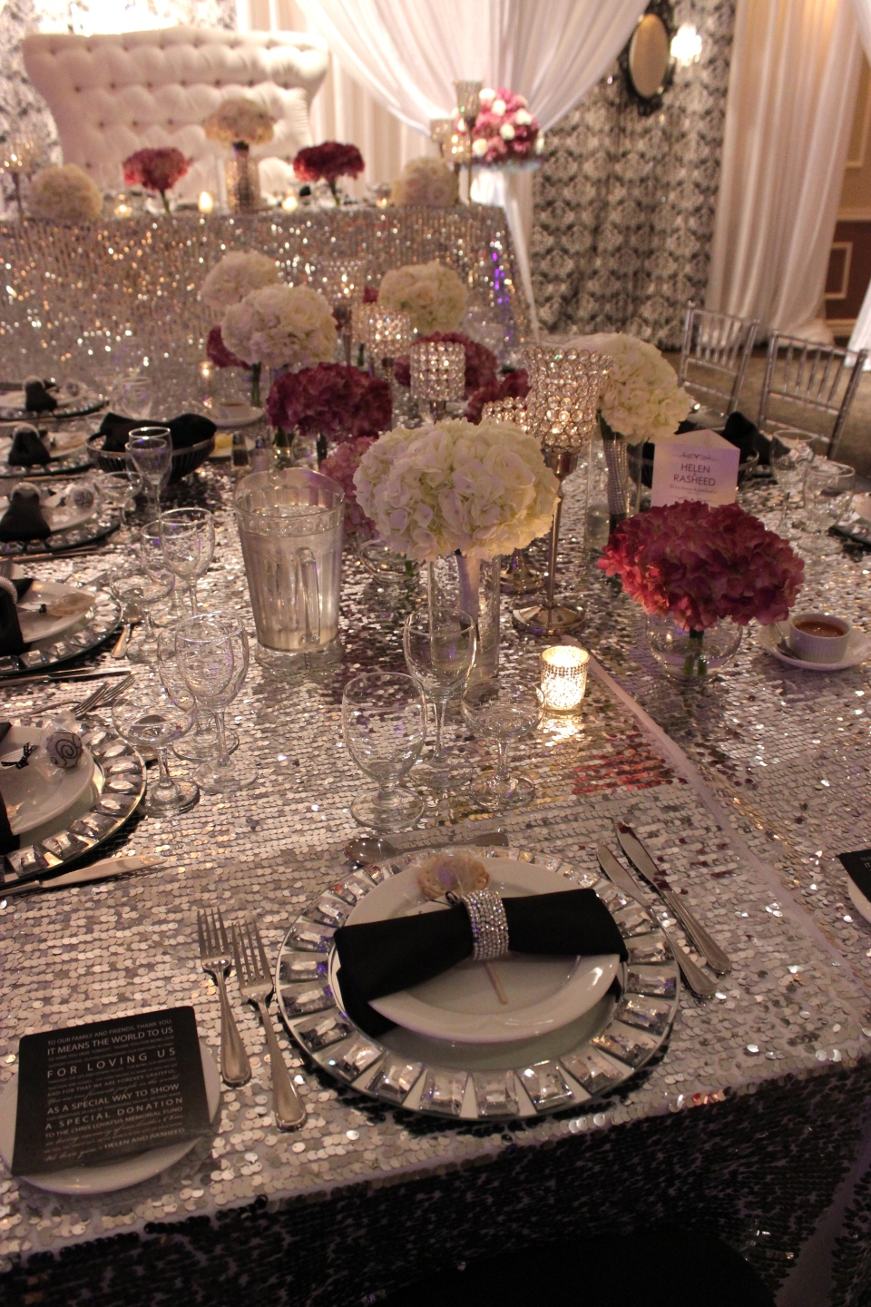 Black, white and silver head table design with purple flowers