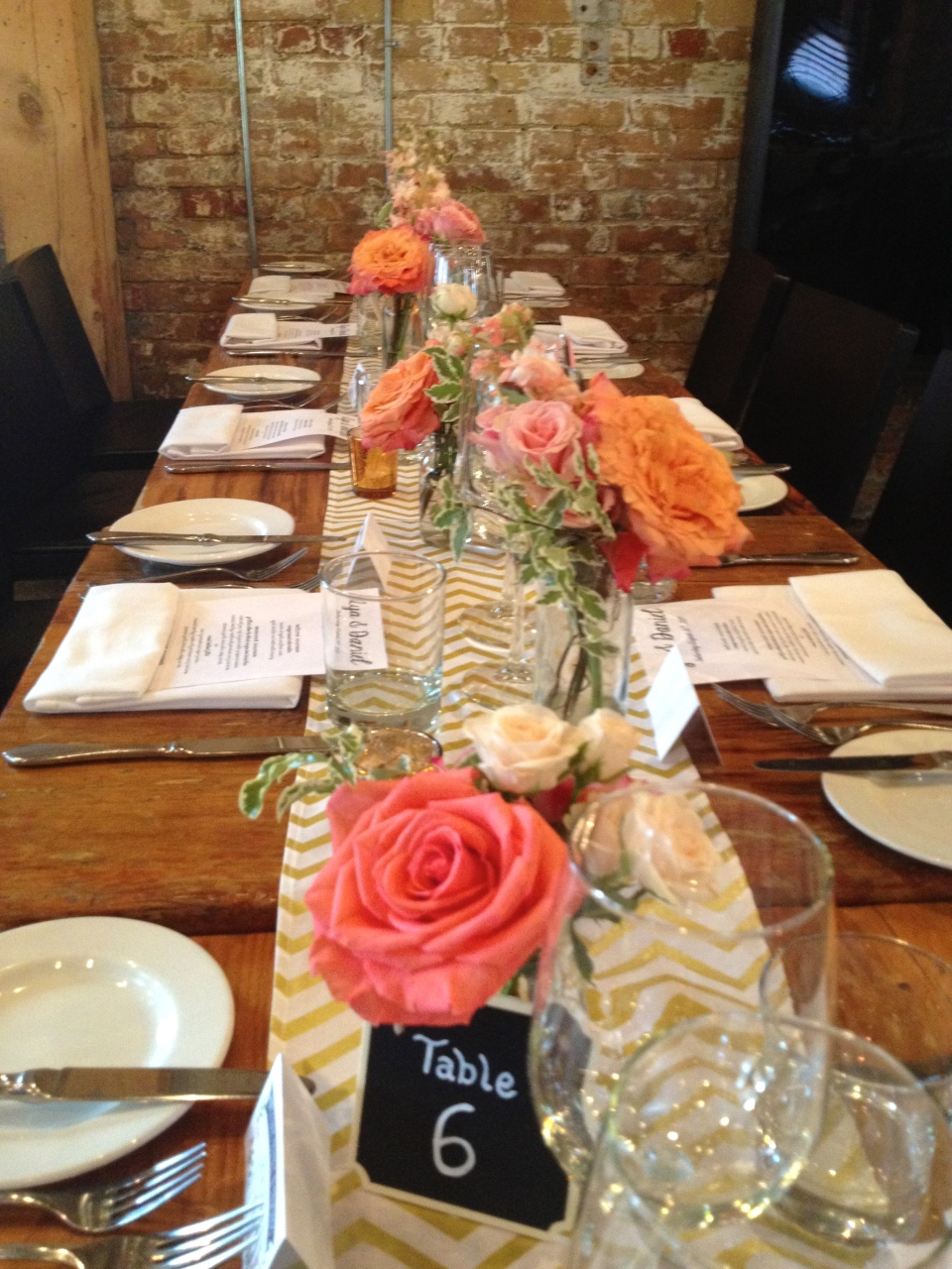 Bud Vases of Roses and Spray Roses Line Long Guest Tables at Archeo