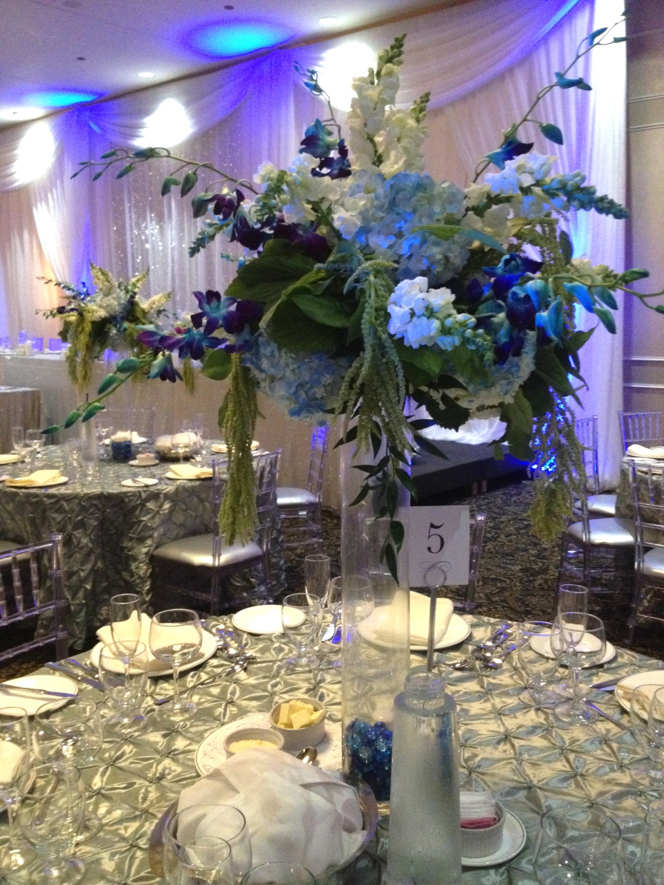 Ocean inspired centerpiece of hydrangea, stock, orchids and amaranthus.