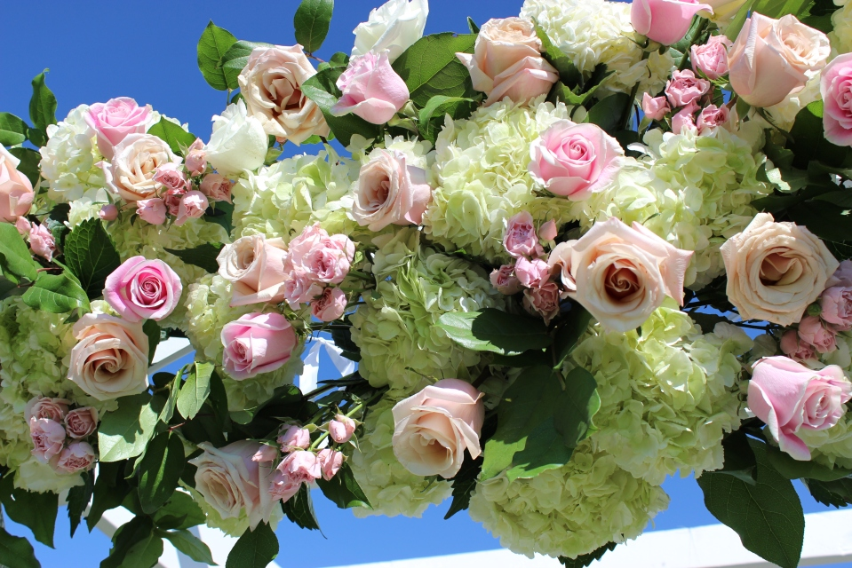 Trellis arrangement of roses, hydrangea and greens