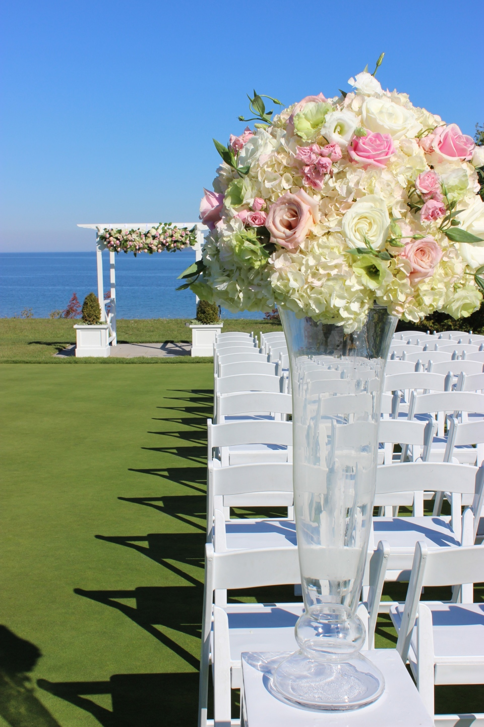 Pink, white and green ceremony arrangement