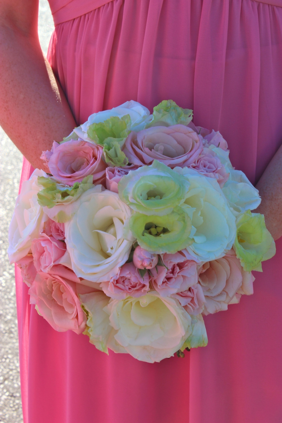 Pink, white and green bouquet of roses and lisianthus