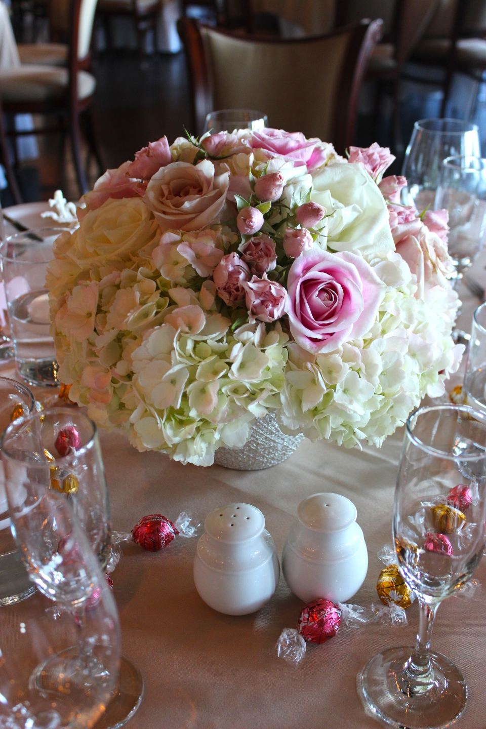 Low pink and white rose and hydrangea centerpiece