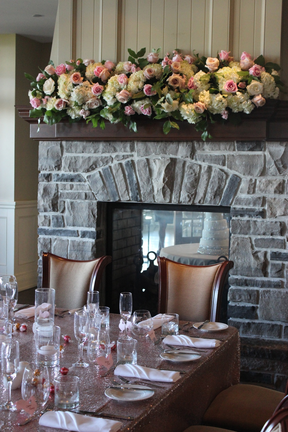 Floral mantle arrangement of hydrangea and roses