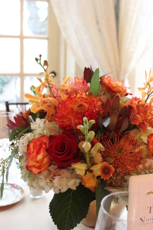 Low Centerpiece of Hydrangea, Roses, Protea, Leucadendron, Mokara Orchids, Snapdragons and Mums