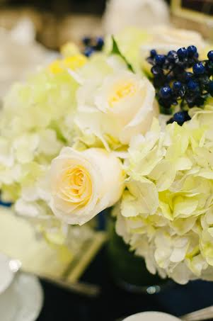 Yellow centerpiece with blue accent berries