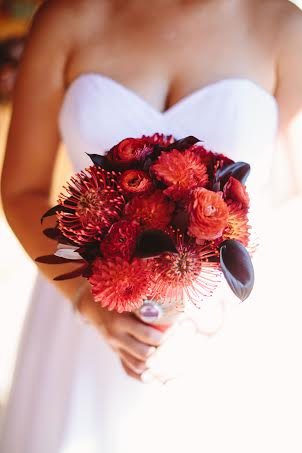 Red bouquet of protea, dahlia's, calla lilies and ranunculus