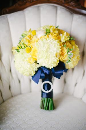 Yellow bridal bouquet with navy ribbon collar