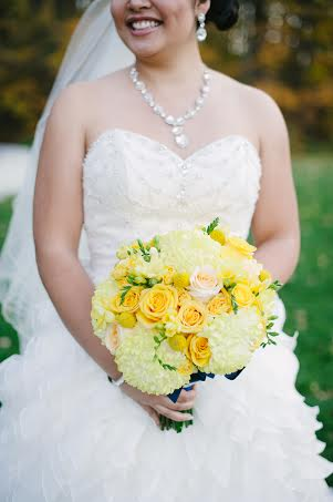 Yellow bridal bouquet of mums, roses and freesia