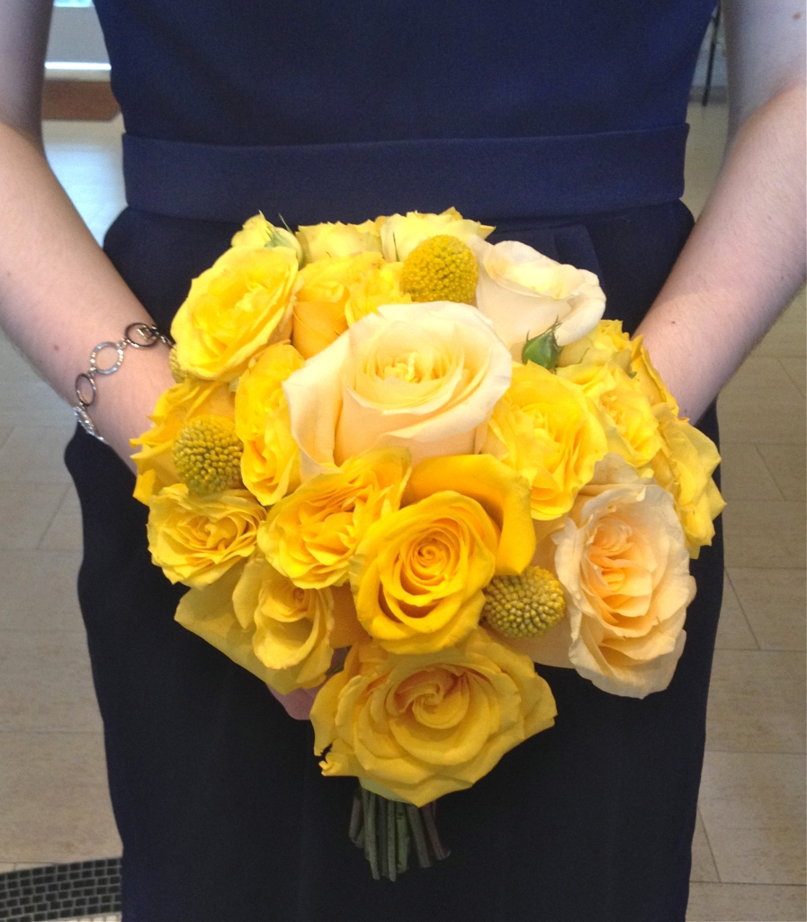 Yellow bouquet of roses and craspedia