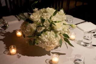 Low white centerpeice of hydrangea, roses and lisianthis