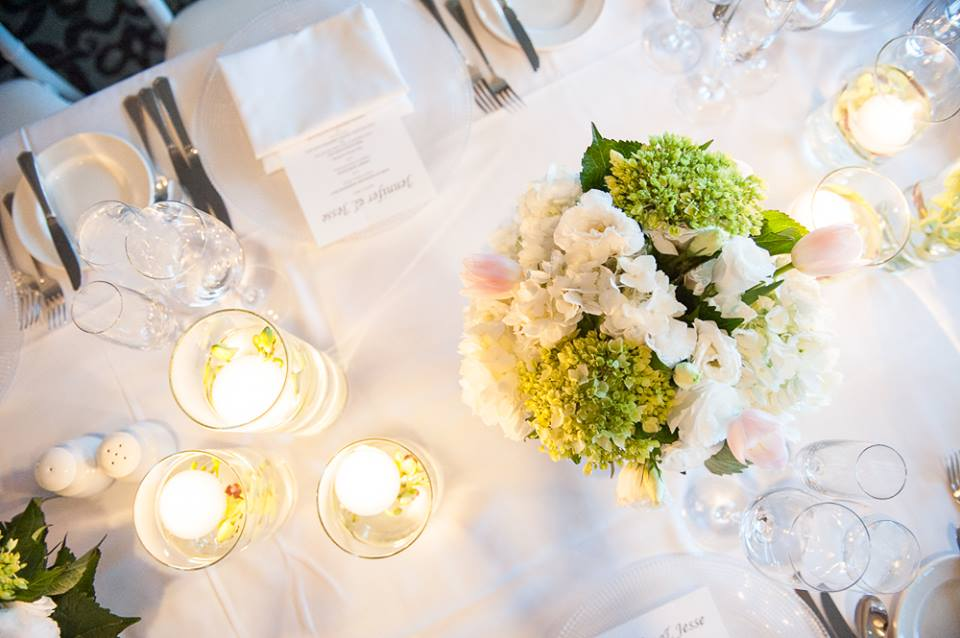 Blush, green and white centerpieces with candles