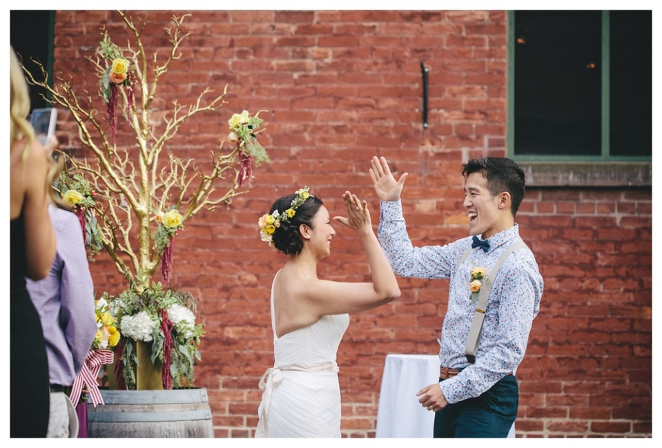 Couple High Five at Wedding Ceremony