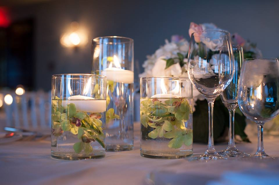 Submerged green orchids with floating candles