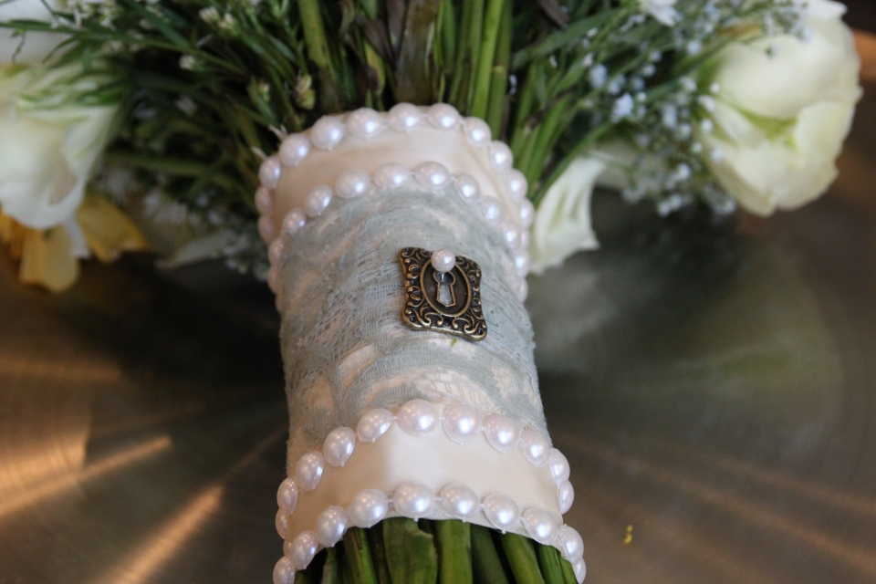Bouquet wrap with lace overlay, pearl trim and lock detail