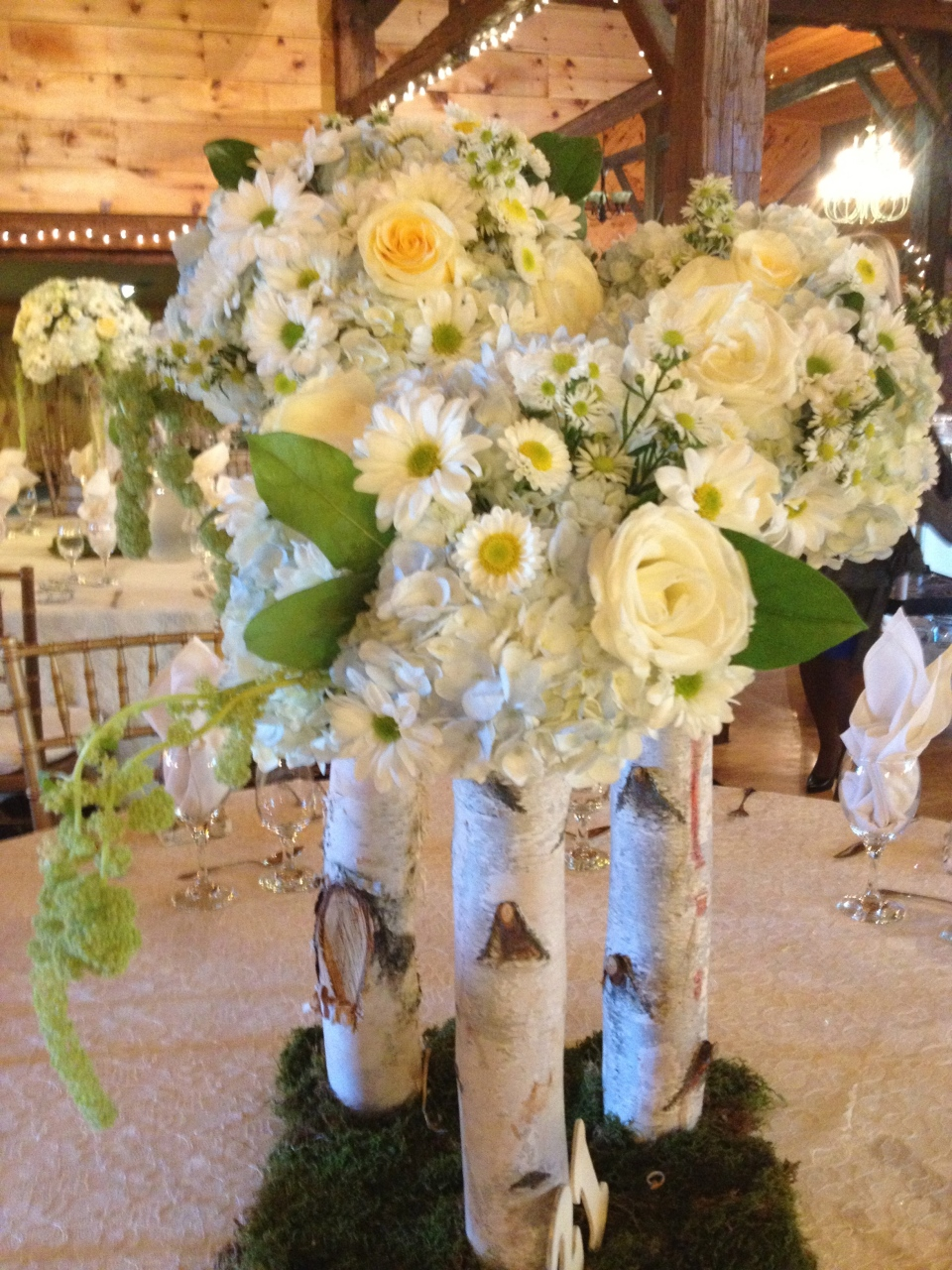 Trio centerpieces of soft yellow and blue wildflowers