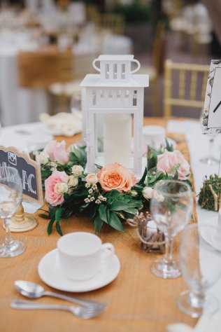 lantern-centerpiece-with-floral-greenery-surround