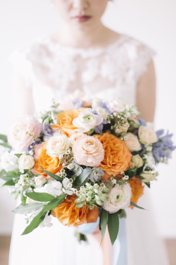 Coral, peach and blue spring bouquet