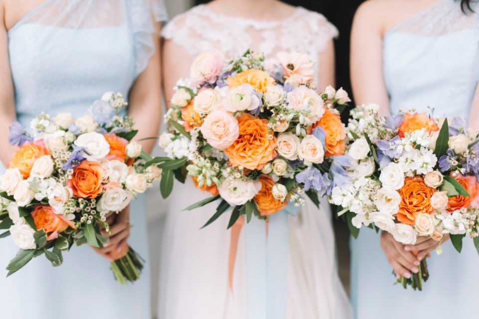 coral, peach and blue bouquets
